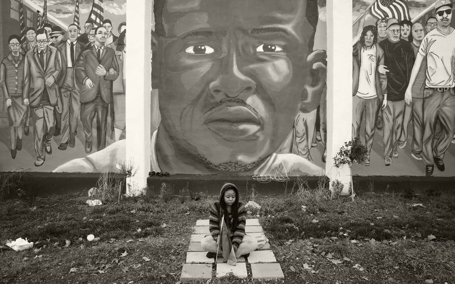 <p> 	BALTIMORE: Jazmin Holloway sits below a mural depicting Freddie Gray at the intersection of his arrest, in Baltimore on Dec. 16, 2015. (AP Photo/Patrick Semansky)</p>