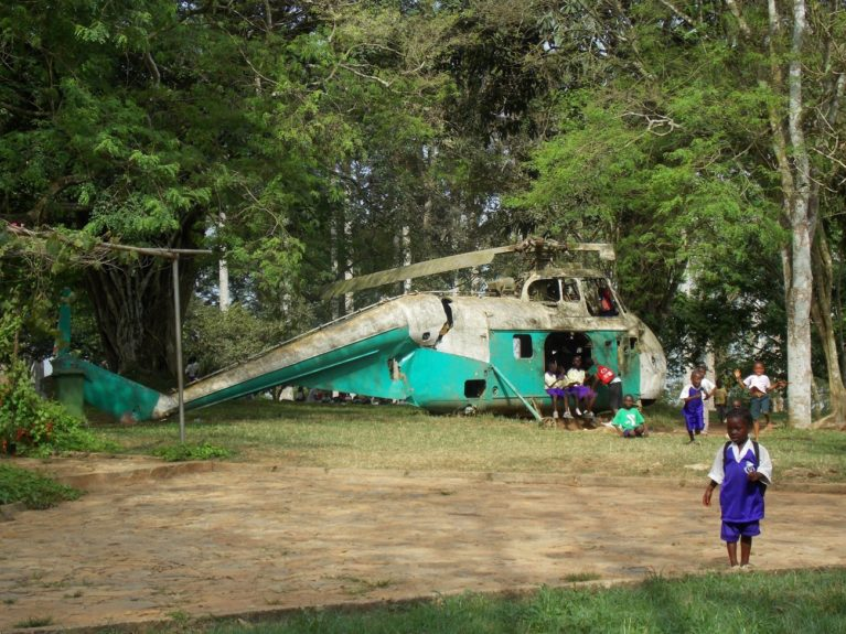 Children play near an abandoned helicopter at the Aburi Botanical Gardens.