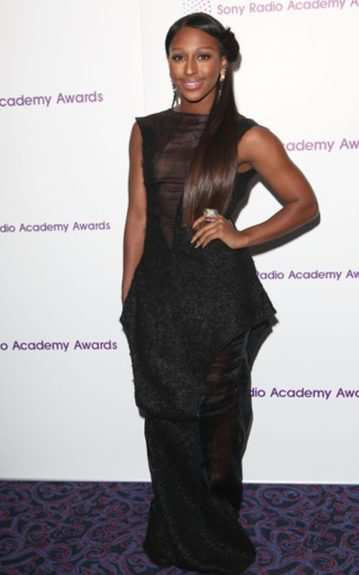 Alexandra Burke dressed up a bit more for the awards in a black gown with sheer panels.