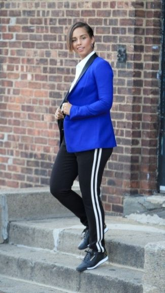 Alicia Keys wears a Robert Rodriguez cobalt blue blazer, white button down, Reebok track pants and sneakers. Photo Credit: Splash