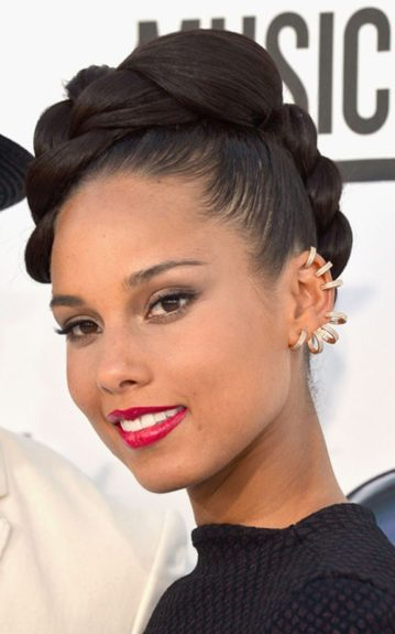 She jazzed things up with diamond hoop earrings running up her entire left ear