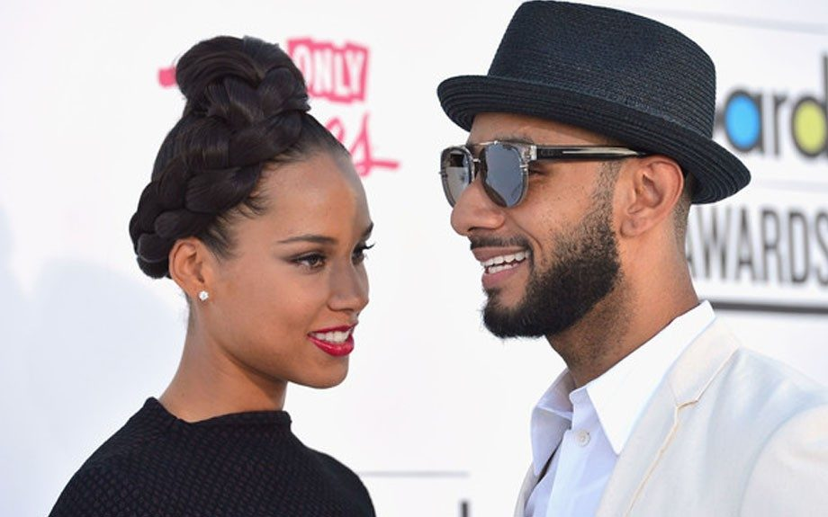 Alicia Keys opted for a braided updo, single diamond stud and a cherry red lip
