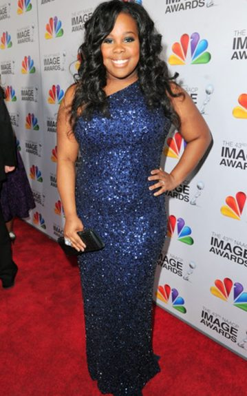 Amber Riley opted for a navy blue sequined gown for the NAACP Image Awards. We find that one-sleeve cuts flatter full figures well as in this case
