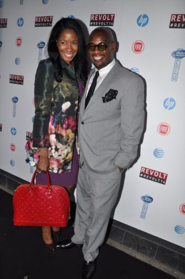 Revolt Vice-Chairman Andre Harrell with guest Erika Pittman