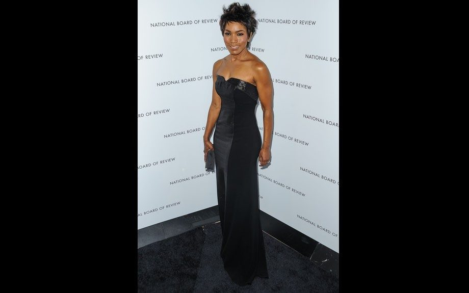 Angela Bassett attended the National Board Of Review Awards last night at Cipriani and looked stunning and svelte in a figure hugging black strapless stretch crepe THEIA gown with a shimmer inset from the Fall 2012 collection.
