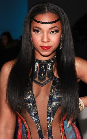 Ashanti posed face-forward in a DIY version of the trend wrapping a hair brand across her forehead. What do you say, love it or leave it?