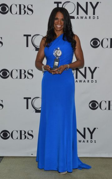 "Audra McDonald looks gorgeous in her electric blue evening gown, as she poses with her Tony ""Best Actress"" award"