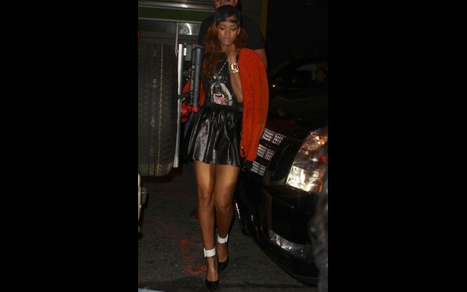 """<span style=""""font-size: 12px;"""">Nobody is better at being a bad girl than Rihanna, and she's </span>killing<span style=""""font-size: 12px;""""> it in a Givenchy </span>Rottweiler<span style=""""font-size: 12px;""""> tee, along with 3.1 Phillip Lim Orange Shearling Jacket, leg baring leather mini skir"""