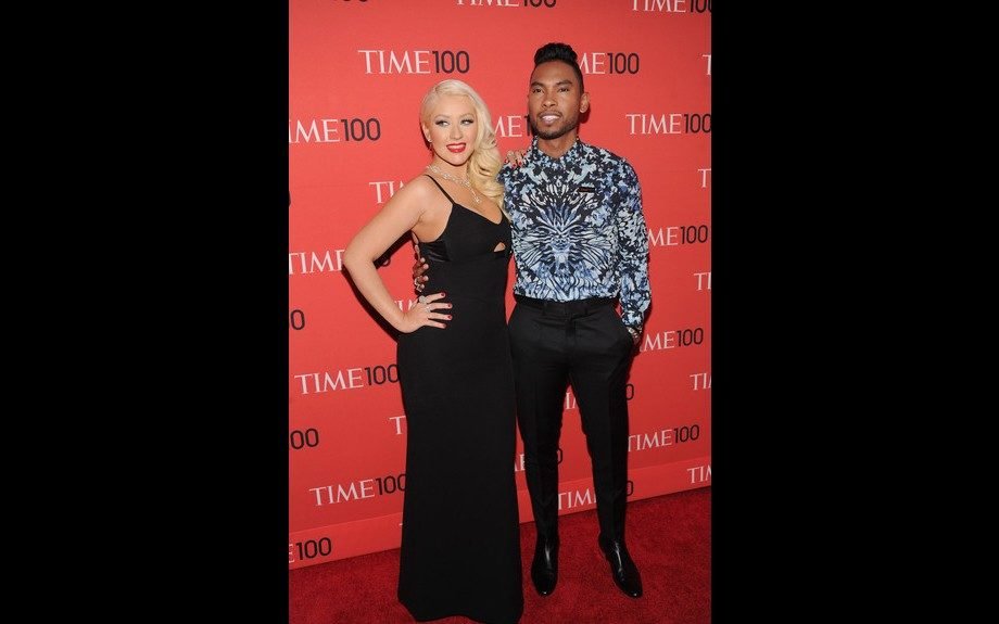 """<span style=""""font-size: 12px;"""">Miguel posed with Christina Aguilera, looking mighty dapper in a Alexander McQueen shirt and black slacks. Photo Credit: </span>WENN"""