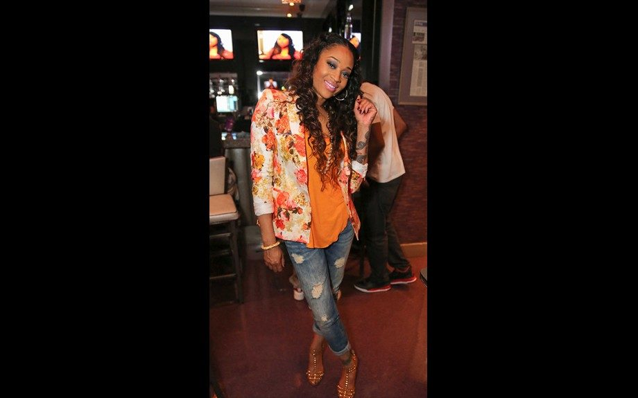 Mimi Faust got some camera time in at a viewing party at Auto Spa Bistro in Atlanta in jeans, an orange top, and Piqué Floral Blazer from Zara. She completed her look with Zara studded sandals. Photo Credit: WireImage