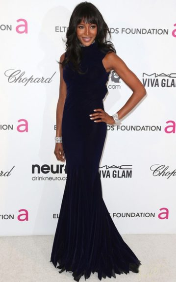 Naomi Campbell took a break from <em>The Face</em> to have some fun in her floor-length gown and diamond cuffs. Photo Credit: Getty
