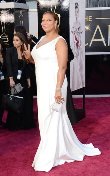 Queen Latifah rocks a crisp white Badgley Mischka gown as she poses on the red carpet. Photo Credit: WENN