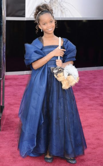 Quvenzhané Wallis melted our hearts in her navy Armani gown and Poochie & Co puppy purse. Photo Credit: WENN