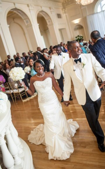 Crazy in Love: The couple shares bright smiles at their reception