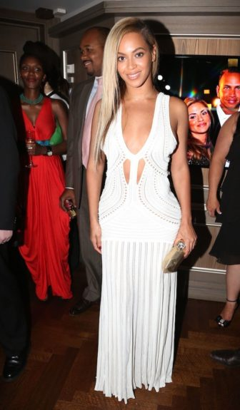 Beyoncé is queen of the cut-outs as she posed it up for hubby Jay-Z's 10th anniversary party at 40/40 in a white cut-out gown by Roberto Cavalli. Photo Credit: Getty