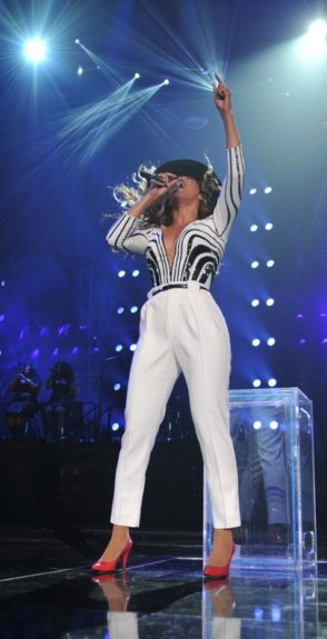 Beyoncé added a new outfit to her Mrs. Carter tour while in New York, and of course she slayed the stage in a white and black custom Gucci beaded top, white pant, and red patent leather pumps. <em>Photo</em>: iambeyonce.com