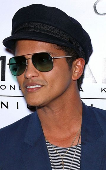 If he ever decides to retire the fedora, this military cap looks just as cool. The aviator shades to match add a nice touch
