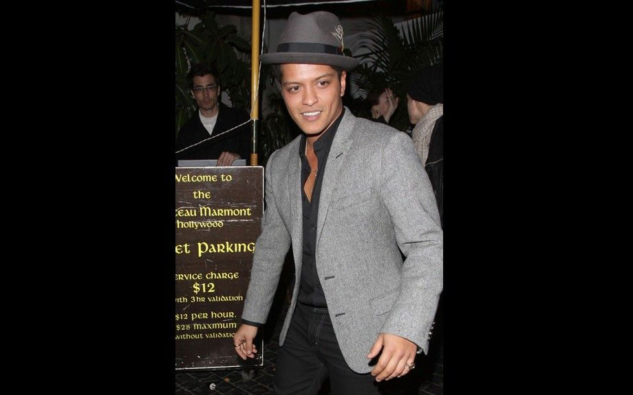 This charcoal grey fedora with a black ribbon wrapped around the brim is the perfect complement to his grey blazer over a black shirt and black jeans