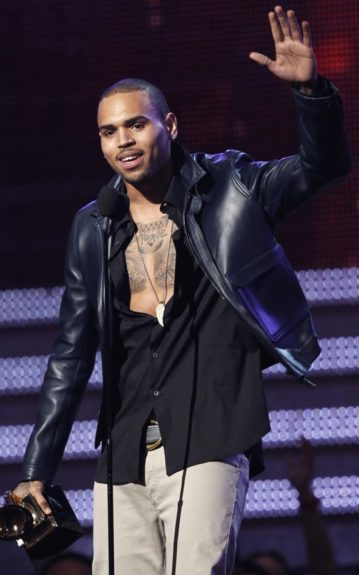 Chris Brown rocks out with his tatts out accepting his win at this year's Grammy Awards