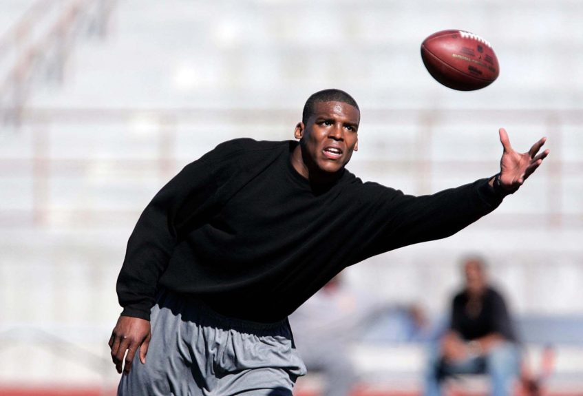 <p> 	Heisman Trophy winner Cam Newton uses the football stadium at Cathedral Catholic High School to show the public and the gathered media how he goes about training.  JOHN GASTALDO/Union-Tribune/Zuma press</p>