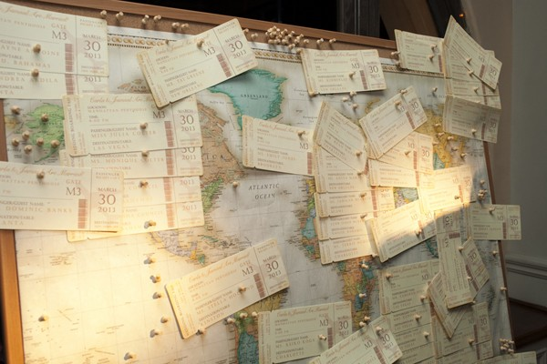 The guests' invitations were sent in the form of boarding passes so when they arrived, they could pin their pass on the cork board to represent where they traveled from.