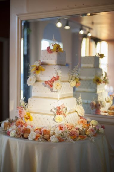 The cake was adorn with regal flowers.