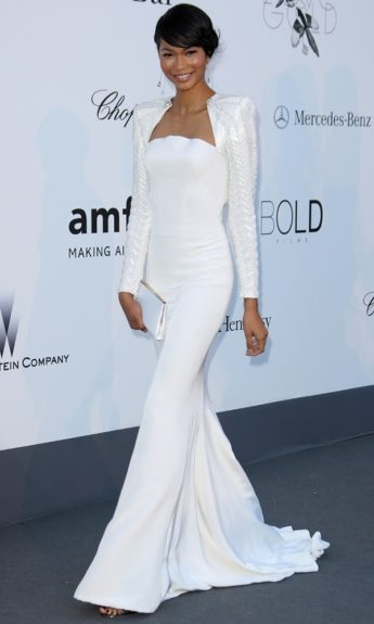 Absolutely stunning, Chanel hangs out in Cannes on hand for the AmFAR Gala in this white Atelier Versace mermaid gown.