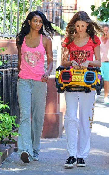 Chanel Iman in sweats, sneakers and a neon pink Victoria's Secret tank
