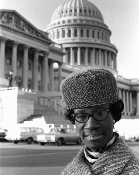 From the EBONY Collection, Shirley Chisholm stands in front of the Capitol Building. (Maurice Sorrell) View the entire EBONY Collection by selecting STORE in the upper right corner of the homepage.