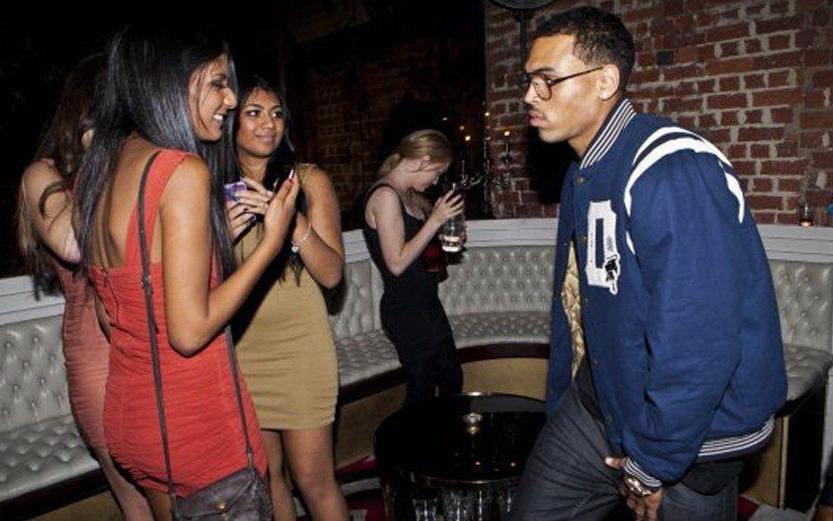 Chris Brown geared up in a letterman jacket and oversized glasses. What do you think about the 'stache he's wearing nowadays? Reminds us of Welcome Back, Kotter!