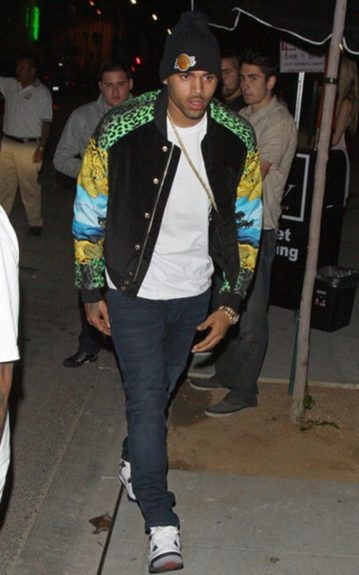 Chris Brown in a Versace for H&M Bomber Printed Jacket and a Lakers knit cap