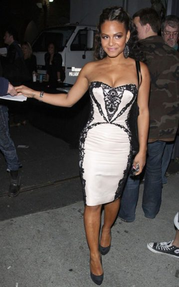 Christina Milian looked classy leaving the Nylon 13th Anniversary Celebration in a black and white lace embellished strapless dress and simple, black pumps.