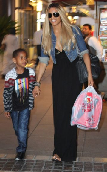 Lala's bestie Ciara, takes Kiyan toy shopping while she has her alone time. In a black maxi dress and denim jacket, Cici is one fly auntie.