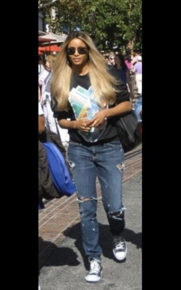 Ciara goes sexy grunge as she strolls in LA, in a printed black tee, ripped jeans, and sneakers, she's just hanging out.