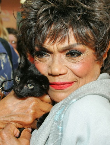 Eartha and her love for cats never tired. Here she poses with a black cat in 2004