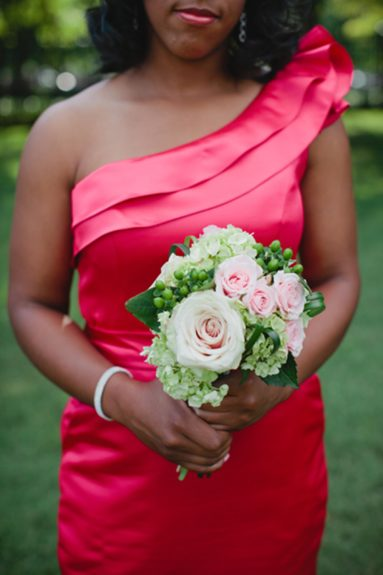 A bridesmaid and her bouqet - neat and simple.