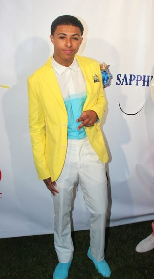 Diggy is handsome in his yellow blazer, white and blue button down, white trousers, and blue loafers at the Simmons' brothers Art for Life event sponsored by Cadillac. Photo Credit: Global Grind