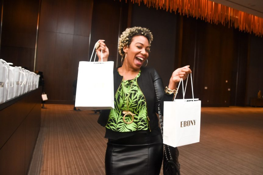 <p> RaVal Davis is thrilled to score a swag bag</p>