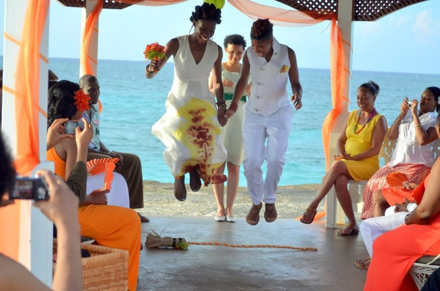 The couple jumped the broom in the tradition of their ancestors on a monumental occasion