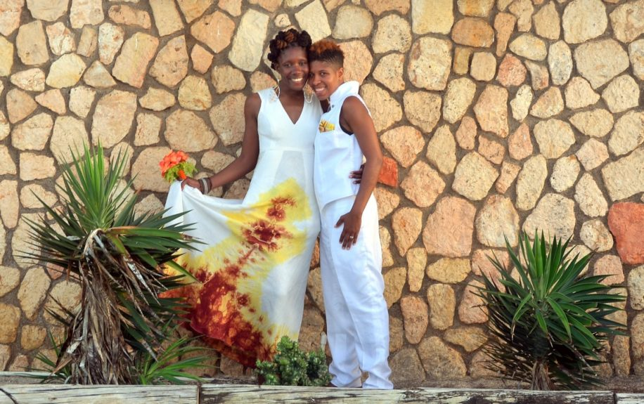 Nicole Y. Dennis  and Dr. Emma Benn strike a pose against luxurious compound of Silver Sands Villa in Duncans, Trelawney