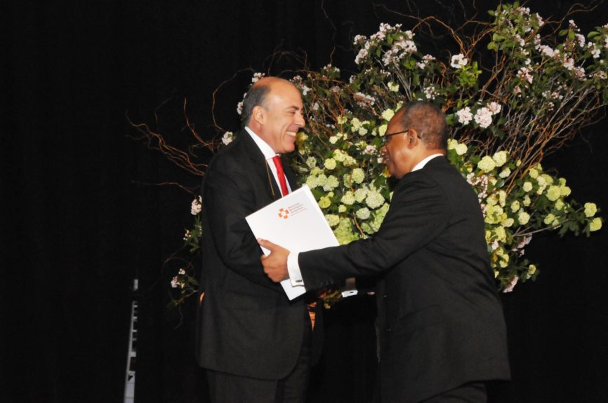 Rev. Dr. Calvin O. Butts, III honors Coca-Cola Chairman and CEO Muhtar Kent with the Harlem Renaissance Day of Commitment Leadership Award at the Abyssinian Development Corp., Annual Harlem Renaissance Day of CommitmentBreakfast