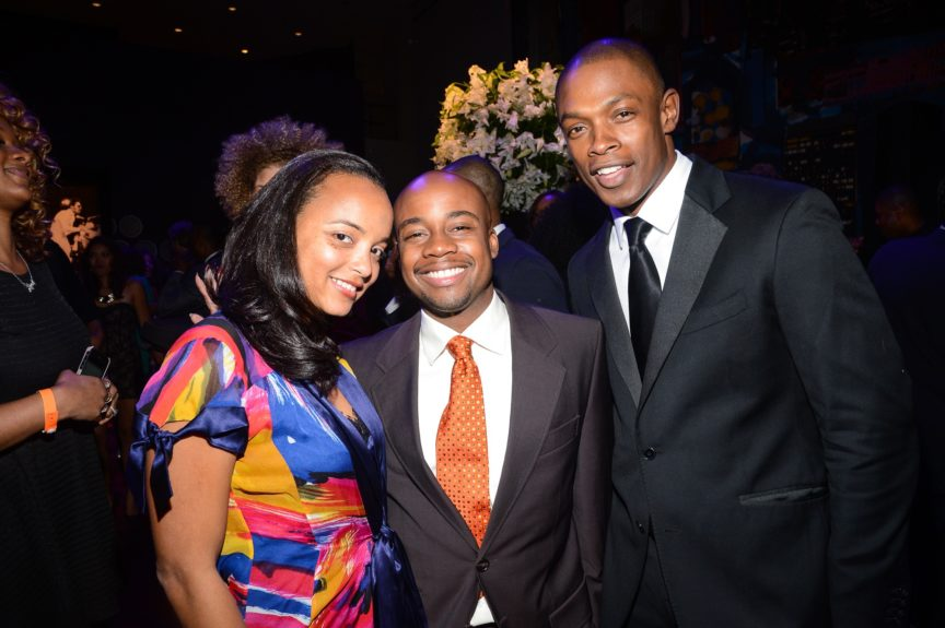 Model Andre Brown (at right) with guests.