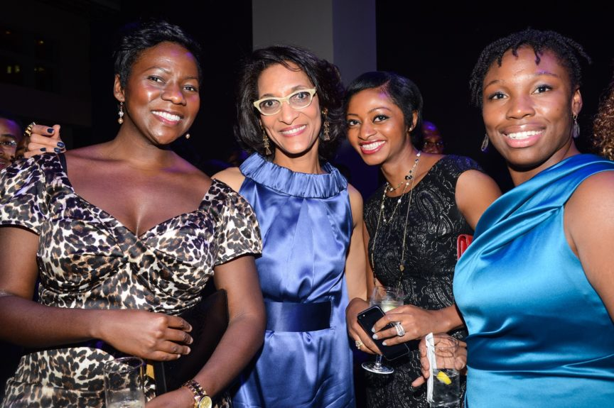 Chef Carla Hall (second from left) with guests.