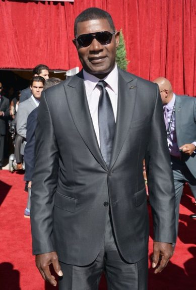 Dennis Haysbert took a break from Allstate to attend the Espy's and he looks mighty dapper in his sheen black suit.