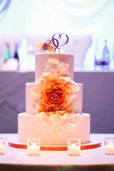 Their cake was very pure and simple, with a bright adornment of rich orange and yellow flowers