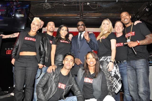 Combs poseswith Revolt hosts and executive vice president of programming Val Boreland