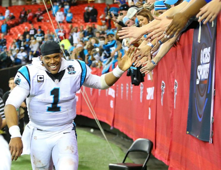 <p> 	Panthers quarterback Cam Newton high fives fans after beating the Falcons to take the NFC South © Curtis Compton/Atlanta Journal-Constitution/TNS</p>