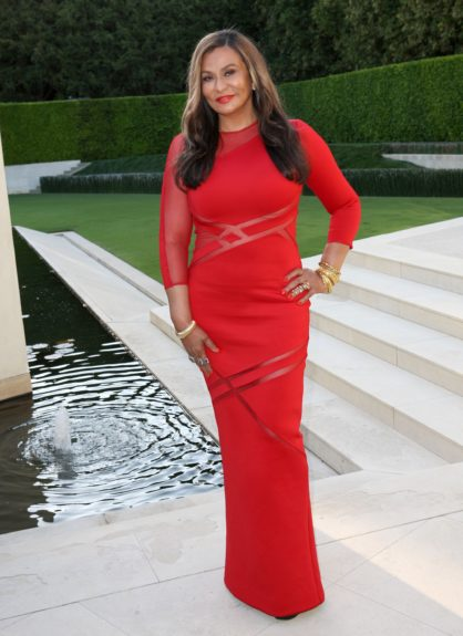 Isn't she lovely? Tina Knowles stuns at the cover party.