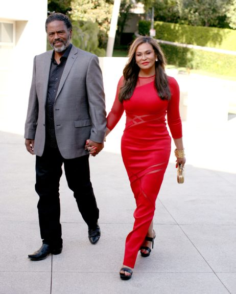 Richard Lawson hand in hand with Tina Knowles at the cover party.