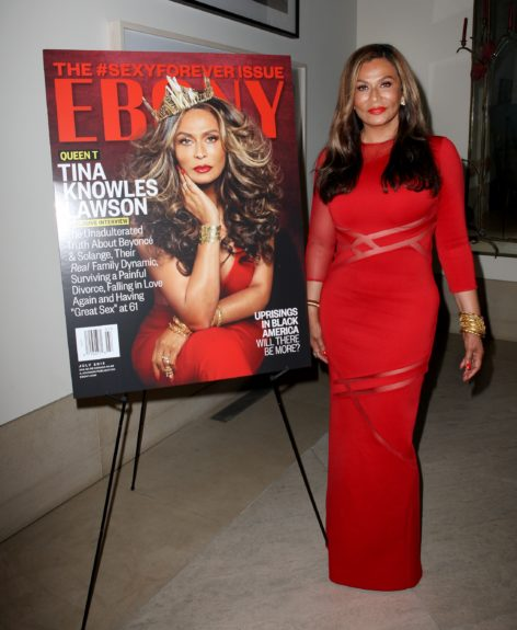 Tina Knowles posted up beside her gorgeous cover at this private party.